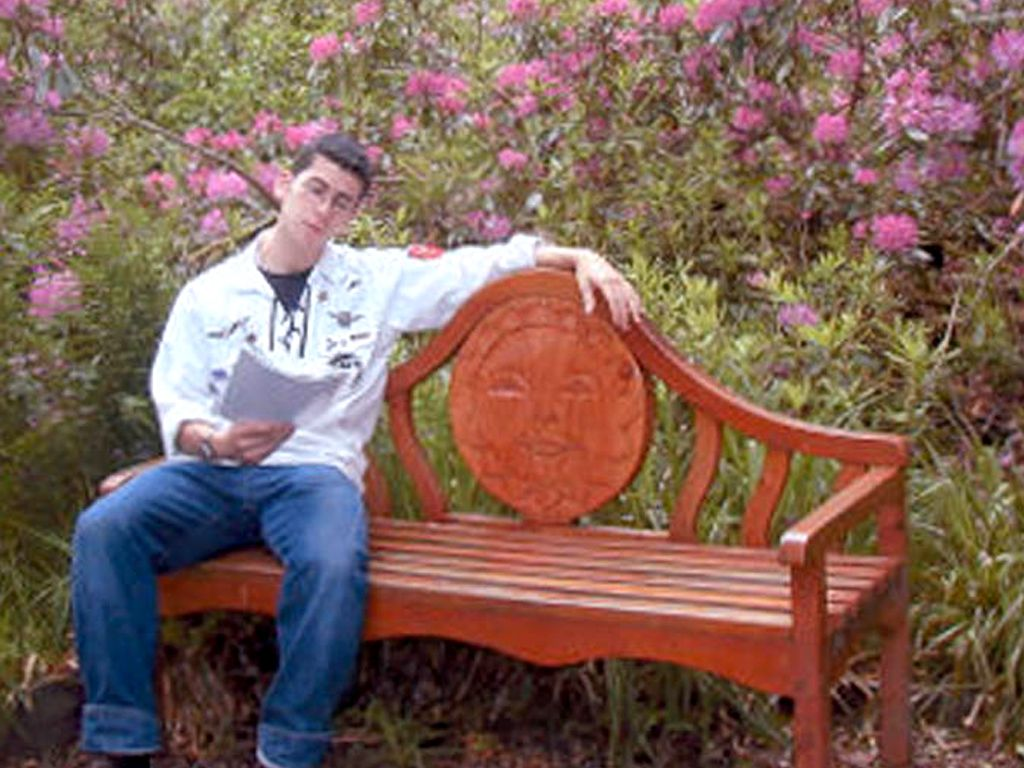 Yoni on a bench in the flower garden
